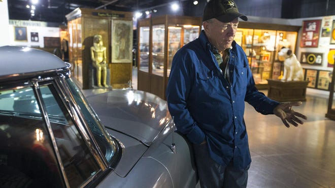 Wayne Lensing, owner of Historic Auto Attractions, stands with Conway Twitty's 1957 Lincoln Continental Mark II at Historic Auto Attractions on Thursday at the museum near Roscoe. Lensing is in the process of rezoning 11 acres to expand the auto museum.