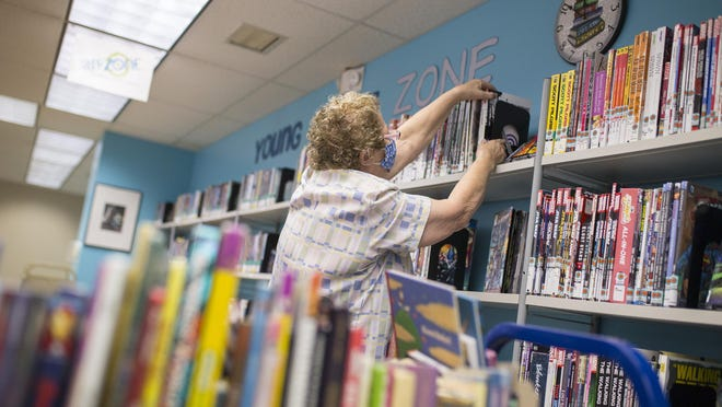 Library page Mary Ann Swartwood shelves and straightens books at the Rockford Public Library's Rock River branch on Thursday.