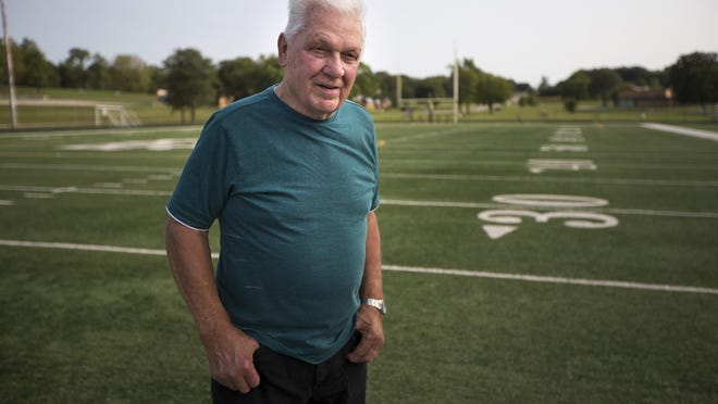 Clint Alsbury of Cherry Valley, a lineman for the 1961 Auburn Knights, stands for a portrait at Auburn High School on Tuesday, Sept. 15, 2020, in Rockford. Auburn's football team went from 0-9 in 1960 to 8-0-1 in 1961.
