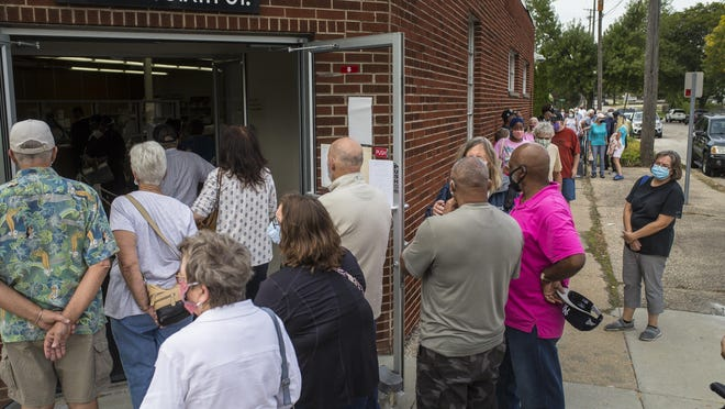 The Rockford Board of Elections, 301 S. Sixth St., had a historic number of people vote on Thursday, the first day of early voting for the 2020 general election. Area residents, shown here standing in line on Thursday, cast 370 ballots.