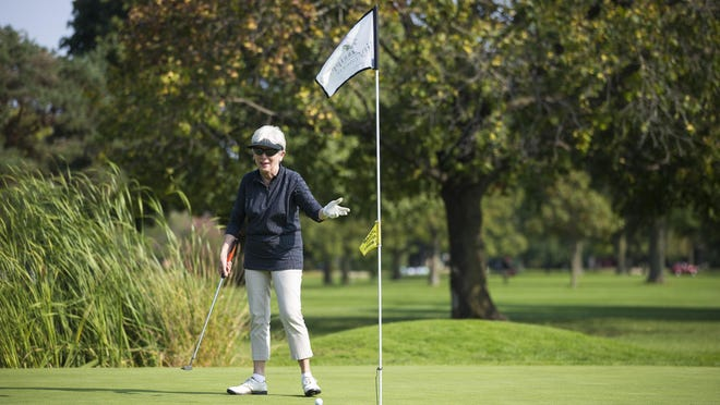 """Linda Reinhardt of Cherry Valley reacts Tuesday after sinking a putt on the ninth hole at Sinnissippi Golf Course. Reinhardt says Sinnissippi is """"the heart of Rockford."""""""