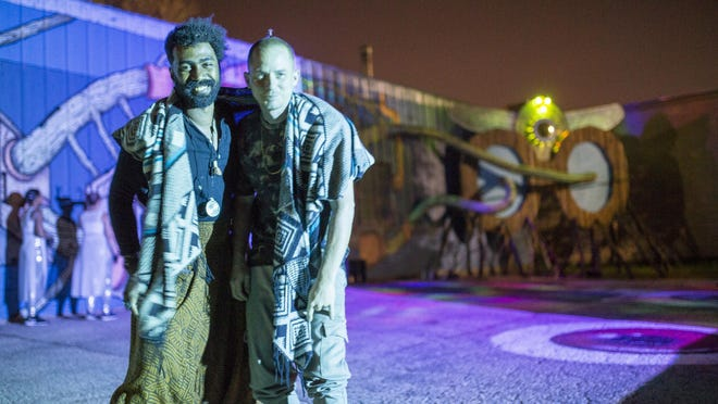 """Artists Eddaviel, left, and Jeremy Klonicki pose for a portrait during rehearsals for """"Alma: A Psychedelic Awakening"""" on Sept. 23 at Fraim and Mortar, 3022 Wallin Ave., Rockford. The show, a response to the stress and uncertainty of the year 2020, combines a three-dimensional multimedia mural with projected light, imagery, sound and live performance."""