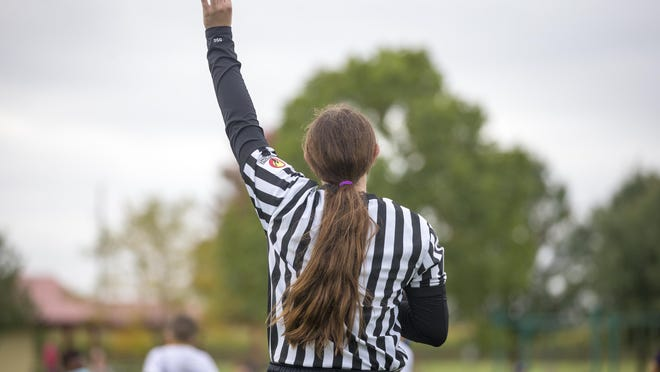 Alexis Trousdale, 16, a student and athlete at Jefferson High School, is training to be an IHSA referee during a junior NFL Flag football event at Clarence Hicks Memorial Sports Park on Saturday in Rockford.