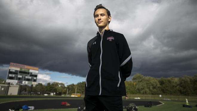 Auburn senior Peter Maculan poses for a portrait at the school's track on Thursday, Oct. 1, 2020, in Rockford. Maculan is one of the cross country team's top runners.