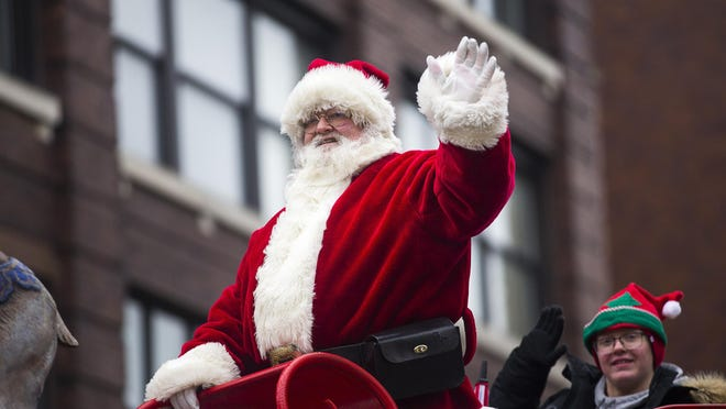 Santa will still make appearances at City Hall in downtown Rockford this Christmas season as part of events presented by Stroll on State, though there won't be a parade this year like the one shown above on Nov. 30, 2019. Restrictions to limit spread of the coronavirus will reduce crowd sizes.