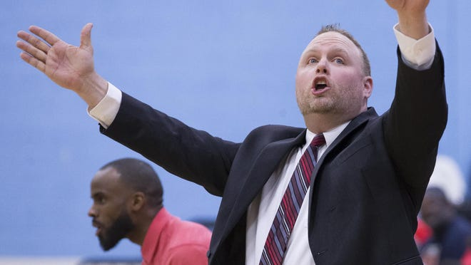 """East boys basketball coach Roy Sackmaster, who led the E-Rabs to a NIC-10-record 34 wins in 2019, gestures during a game against Guilford in 2020. He said the state's decision to shut down the 2020-21 season """"defies logic."""""""