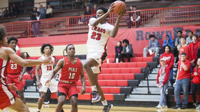 East's Markarious Luster (23), shown grabbing a rebound against Indianapolis Pike last year, was expected to be one of the top seniors in the NIC-10 this year, but players and coaches don't yet know if there will be a basketball season.