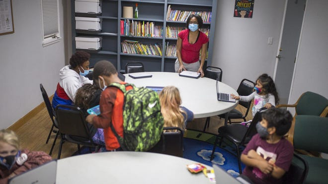 Children participate in after-school activities at Ken-Rock Community Center on Friday in Rockford. The community center is raising money to try to offset financial losses caused by the coronavirus pandemic.