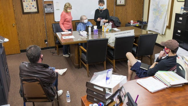 Election judges Sharon Dodge, from left, Teresa Wilmot and Ruth Guenzler, verify vote-by-mail ballots Friday, Nov. 6, 2020, at Rockford Board of Elections. Poll watchers Alexander James Franklin, left, and Johnathon Giesecke, observe.