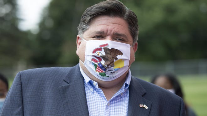 Gov. JB Pritzker, shown July 16 in Rockford, said Thursday that Illinois House Speaker Michael Madigan's implication in a ComEd bribery scandal hurt the Democratic Party.