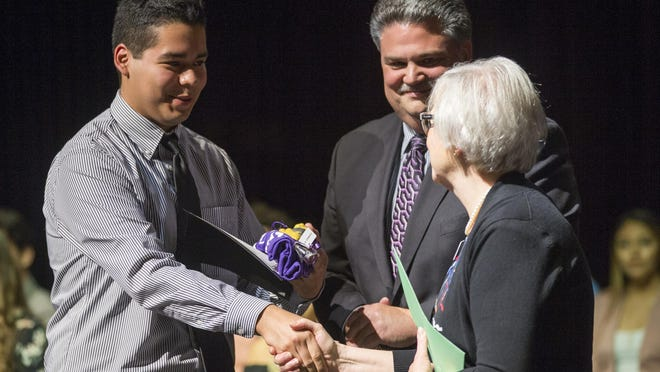 East High School senior Aldo Sapien is recognized for receiving a four-year scholarship to Rockford University on April 27, 2018, during the Rockford Promise scholarship presentation at Rockford University's Maddox Theater.