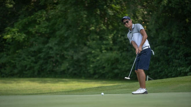 Robert Dofflemyer III, shown putting while winning his first Mauh-Nah-Tee-See Match Play title last year, repeated as champion Sunday by beating former Winnebago star Marcus Smith in Sunday's championship match.