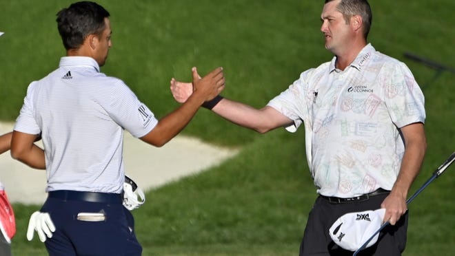 Xander Schauffele, left, congratulates Jason Kokrak after the 18th hole in the final round of the CJ Cup golf tournament at Shadow Creek Golf Course, Sunday, Oct. 18, 2020, in North Las Vegas.