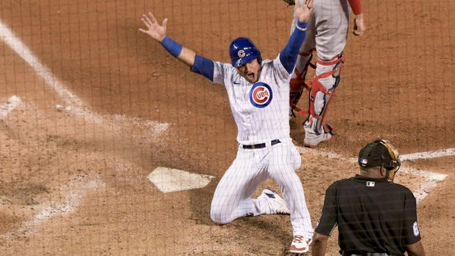Chicago Cubs Willson Contreras (40) celebrates after scoring on a triple by Chicago Cubs Jason Heyward (22) during the fourth inning against the St. Louis Cardinals on Tuesday in Chicago.