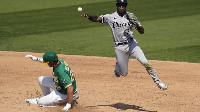 Chicago White Sox shortstop Tim Anderson (7) forces out Oakland Athletics' Matt Olson, left, at second base on a double play Wednesday in Oakland, Calif.