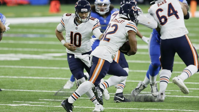 Chicago Bears quarterback Mitchell Trubisky (10) hands off to running back David Montgomery (32) in the second half of an NFL football game in Detroit, Sunday, Sept. 13, 2020.