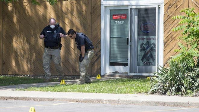 Rockford police investigate the scene where two people were shot at the 3400 block of North Main Street on Saturday, June 6, 2020, in Rockford.