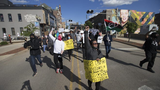 Protesters march throughout downtown on Saturday, May 30, 2020, in Rockford.