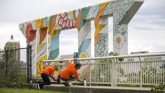 Nancy Hillman of Rockford, left, and Tim Carlson of Monroe Center, clean the railings along the riverbank during the second of two Rockford Sharefest volunteer beautification projects on Tuesday, June 11, 2019, at Davis Park in Rockford. Sharefest is on hiatus this summer because of the coronavirus.