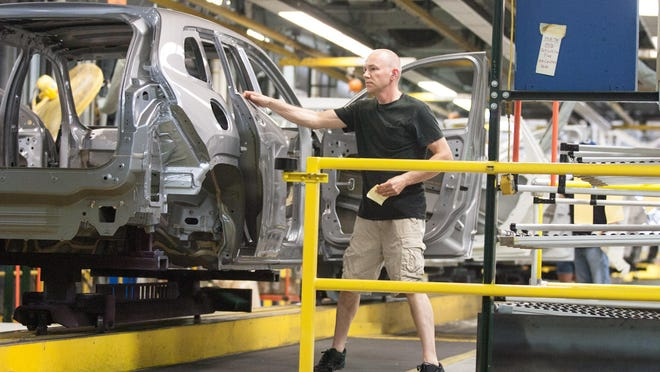 In this 2018 file photo, a factory worker assembles a Jeep Cherokee at the FCA Belvidere Assembly Plant in Belvidere.