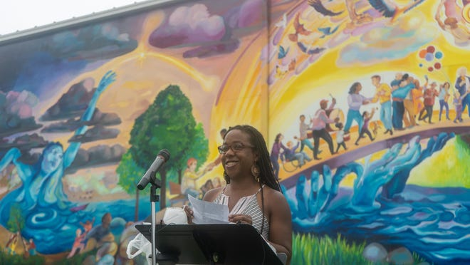 """Tia Richardson, the lead artist in creating the city's newest mural, """"Rockford Takes Flight,"""" talks about what creating this piece means to her during an unveiling ceremony on Monday at SecondFirst Church in Rockford."""
