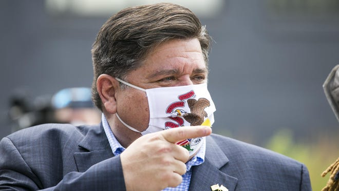Gov. JB Pritzker, shown last week at Rockford City Market, said Wednesday he will extend the pandemic-related moratorium on evictions.