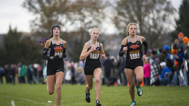 Winnebago's Marissa Roggensack, left, Katie Erb and Kaylee Woolery finish together in sixth, seventh and eighth place during the Class 1A girls cross country sectional on Nov. 2, 2019, in Oregon. The 2020 cross country season begins with practice on Monday, followed by the first competitions on Aug. 24.