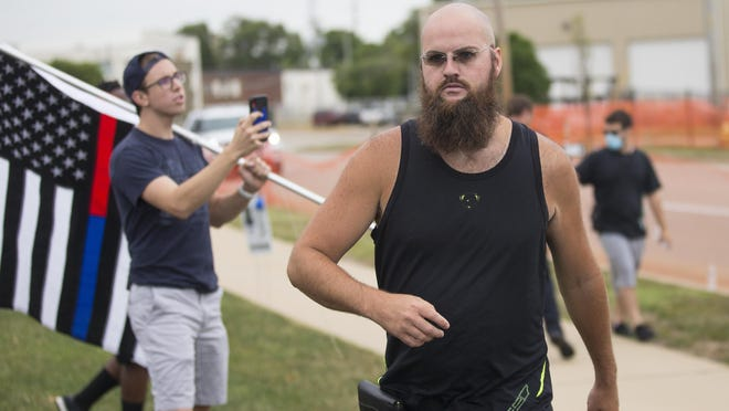 Steven M. Edenburn, 33, of Belvidere was charged with aggravated battery and robbery stemming from fights that broke out Saturday after the Back the Blue rally outside the Winnebago County Justice Center in Rockford.