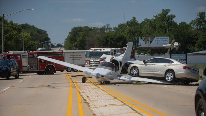 A small plane and a car collided on Auburn Street on Friday in front of the Cottonwood Airport in Rockford. The plan made an emergency crash landing after engine failure, slid off the grass runway and crashed through a chain-link fence onto Auburn Street.