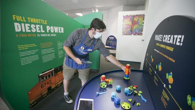 Chase Fischer, an education specialist at Discovery Center Museum, operates a robot at a maker space at Discovery Center Museum on Tuesday in Rockford. Woodward and the Discovery Center Museum mark the grand opening of the museum's new Energy on the Move exhibit. The interactive exhibit demonstrates ways in which Woodward creates energy control systems for machines on land, in the air and in the water.