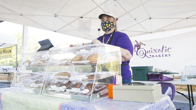 Judy Johnson, owner of Quixotic Bakery, works the weekly Rockford City Market on Friday in downtown.