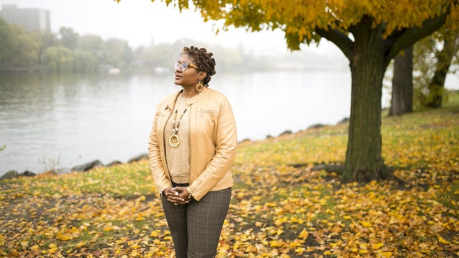 Tasha Davis, executive director of Rockford Promise, found her passion for education while growing up in the Cabrini-Green housing project in Chicago, where she interacted with multiple community organizations. She's pictured Thursday on the banks of the Rock River.