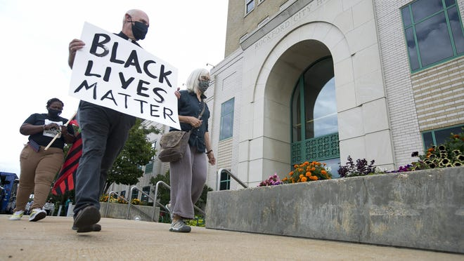 Rockford-area clergy members hold a prayer march around Rockford City Hall on Aug. 5 to show support for the NAACP and Eliminate Racism 815 and to call for a Community Accountability Board to review violent encounters with the police and sheriff's department.