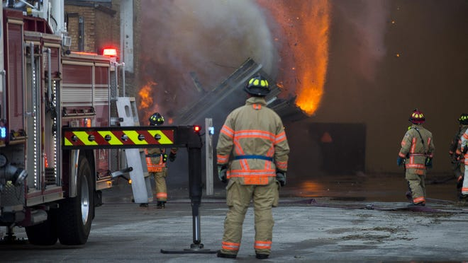 Rockford firefighters battle a large blaze in the 2500 block of North Main Street on Saturday in Rockford. The fire was reported at about 5:15 a.m. at the former Atwood industrial building, a vacant facility that fire officials say has long been slated for demolition.