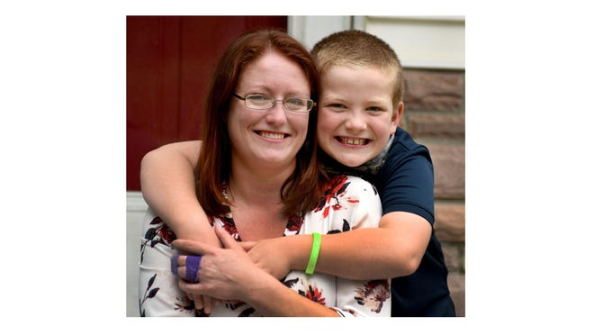 Wyatt Musulin, 7, of Monroe Township, came to his mother, Jennifer Musulin's rescue, when she was attacked by a foster dog.