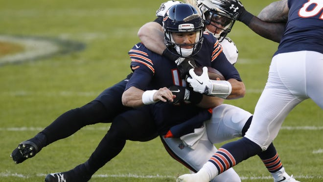 Chicago Bears quarterback Mitchell Trubisky (10) is brought down by New Orleans Saints middle linebacker Alex Anzalone (47) during Sunday's game in Chicago.