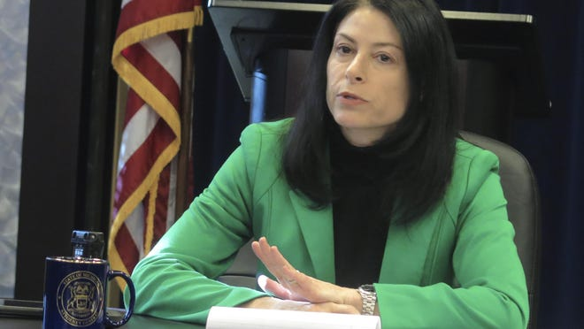 Michigan Attorney General Dana Nessel speaks with reporters about her first year in office on Monday, Dec. 23, 2019, at her office in Lansing, Mich. On Thursday, June 4, Nessel joined a lawsuit against the Department of Education over a new Title IX rule.