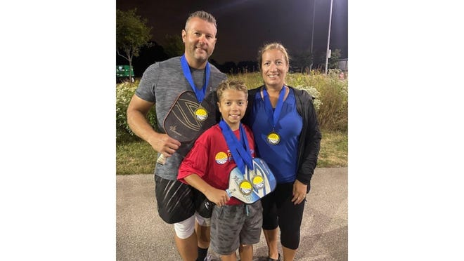 Mark, Jenee and Dominic Osborne show some of the medals they won during the recent Chicago Open Pickleball Tournament.