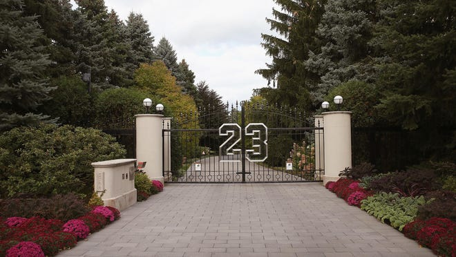 A gate with the number 23 controls access to the home of basketball legend Michael Jordan on Oct. 21, 2013 in Highland Park.