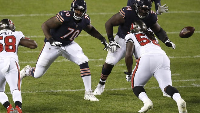 Chicago Bears offensive tackle Bobby Massie (70) and offensive guard Germain Ifedi (74) set to block against the Tampa Bay Buccaneers in Chicago, Thursday, Oct. 8.