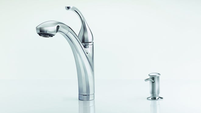In most cases, a stainless steel kitchen sink can be drilled with a special bit to create a fifth hole for a new soap dispenser.