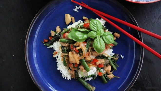 Green beans add crunch to the popular Thai stir-fry dish basil chicken while minced chile peppers add heat.