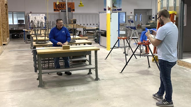 Doug Wiersma, a professor at Grand Rapids Community College, appears in a video taping for his construction students at GRCC March 23, 2020 in the school's shop in Grand Rapids. Many Michigan college students' futures are being delayed during the coronavirus pandemic. In-person classes stopped in the state due to safety concerns surrounding the coronavirus.