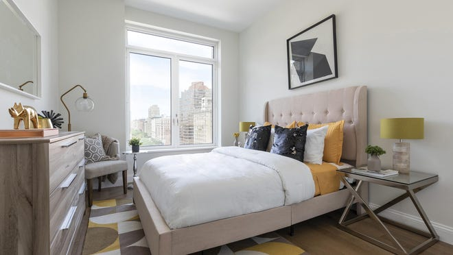 Gold, black and tan help make this bedroom feel modern and fresh.