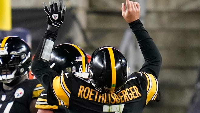 Pittsburgh Steelers quarterback Ben Roethlisberger (7) celebrates a touchdown pass to wide receiver Chase Claypool during the second half of an NFL football game against the Cincinnati Bengals, Sunday, Nov. 15, 2020, in Pittsburgh. (AP Photo/Keith Srakocic)