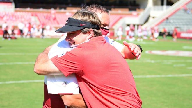 Georgia head coach Kirby Smart greets Arkansas head coach Sam Pittman before the Bulldogs' game with Arkansas in Fayetteville, Ark., on Saturday, Sept. 26, 2020.