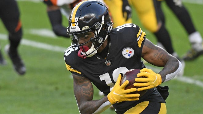 Pittsburgh Steelers wide receiver Diontae Johnson runs after a catch during the first half  against the Cincinnati Bengals last Sunday. Johnson, JuJu Smith-Schuster and Chase Claypool are poised to have productive fantasy days against the Jacksonville Jaguars.