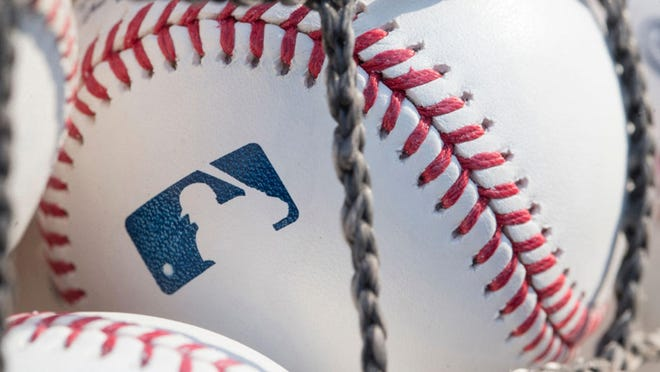 A baseball with MLB logo is seen at Citizens Bank Park before a game between the Washington Nationals and Philadelphia Phillies on June 28, 2018 in Philadelphia, Pa. Players will begin shortened training camps beginning on July 1.
