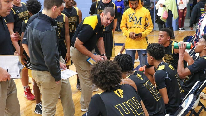 Kings Mountain boys basketball coach Grayson Pierce instructs the team during 2019 game at Hunter Huss in Gastonia.