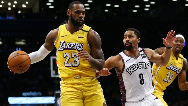 The Los Angeles Lakers' LeBron James (23) drives to the basket against the Brooklyn Nets' Spencer Dinwiddie (8) at Barclays Center in New York on January 23, 2020.